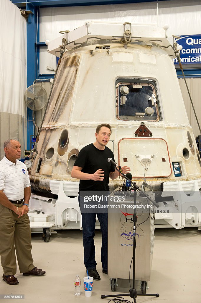 NASA administrator Charles Bolden left listens as SpaceX CEO and Chief Designer Elon Musk answers questions about the private Dragon spacecraft that...