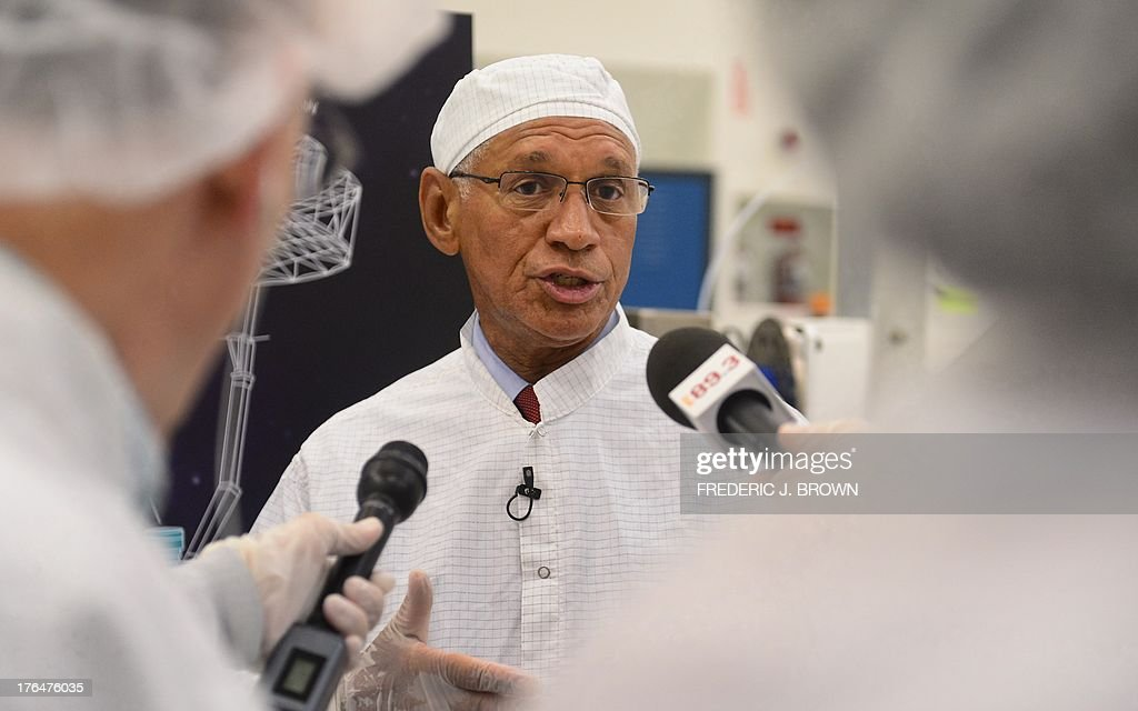 Administrator Charles Bolden responds to question while touring the Spacecraft Assembly Facility Cleanroom at the Jet Propulsion Laboratory in Pasadena, California on August 13, 2013, to see the progress and assembly of the Soil Moisture Active Passive (SMAP) satellite presently under construction and due to launch in October 2014. SMAP will produce global maps of soil moisture for tracking water availability around the planet, and will also detect winter freeze and spring thaw to track changes in growing season patterns, allowing scientists to determine how much carbon plants take up from the atmosphere each year. AFP PHOTO/Frederic J. BROWN