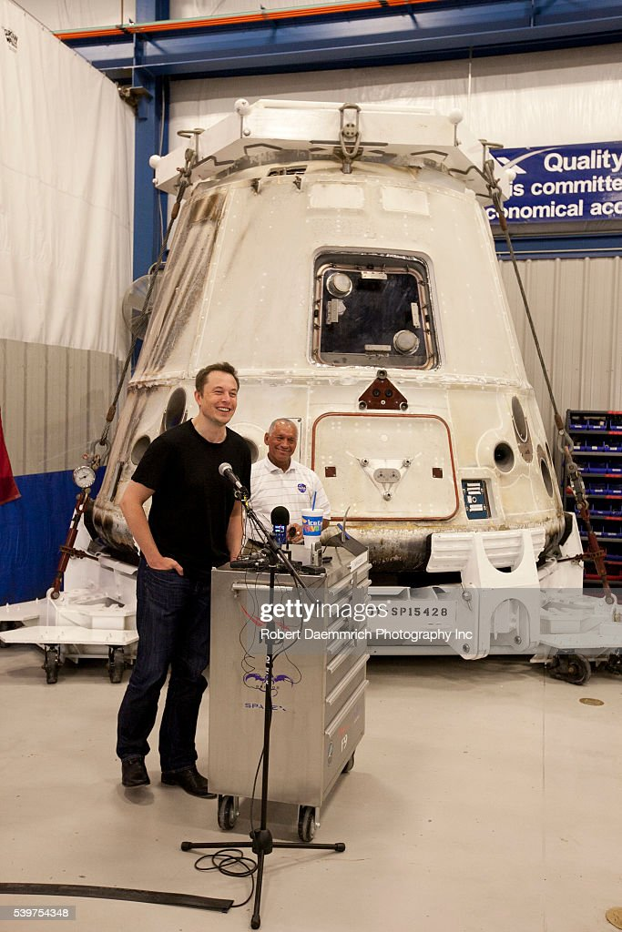 NASA administrator Charles Bolden right and SpaceX CEO and Chief Designer Elon Musk left answer questions about the private Dragon spacecraft that...