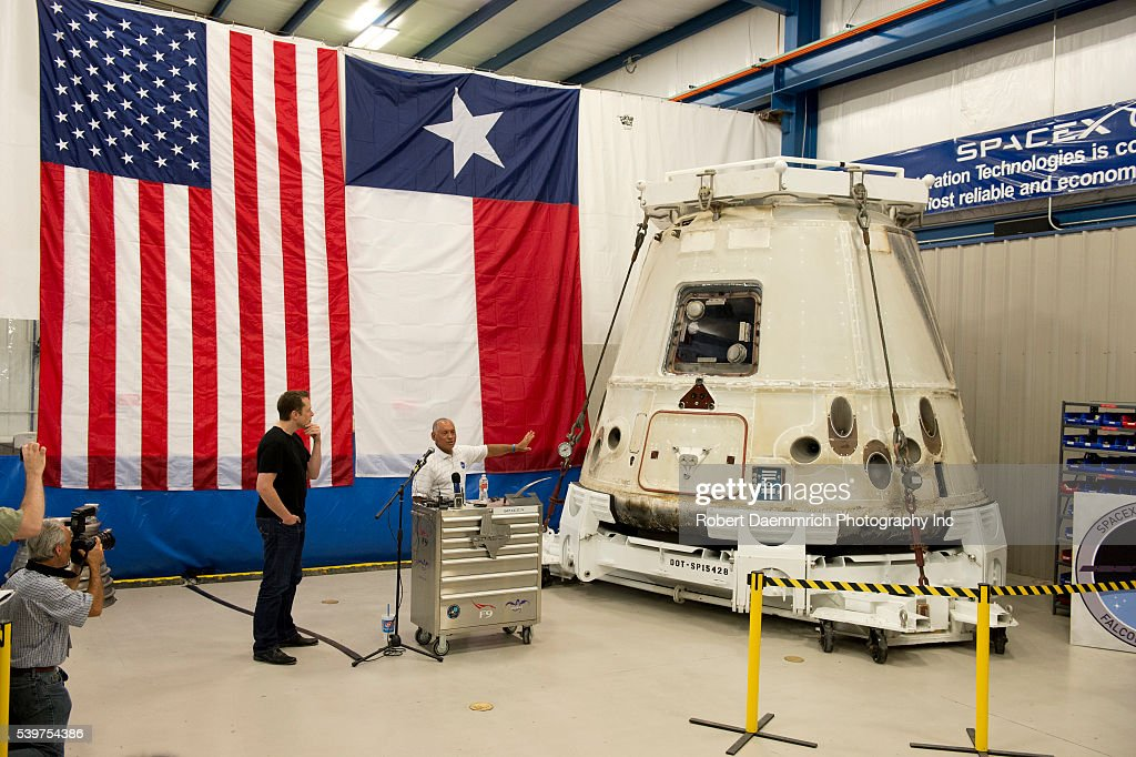 NASA administrator Charles Bolden right and SpaceX CEO and Chief Designer Elon Musk answer questions about the private Dragon spacecraft that...