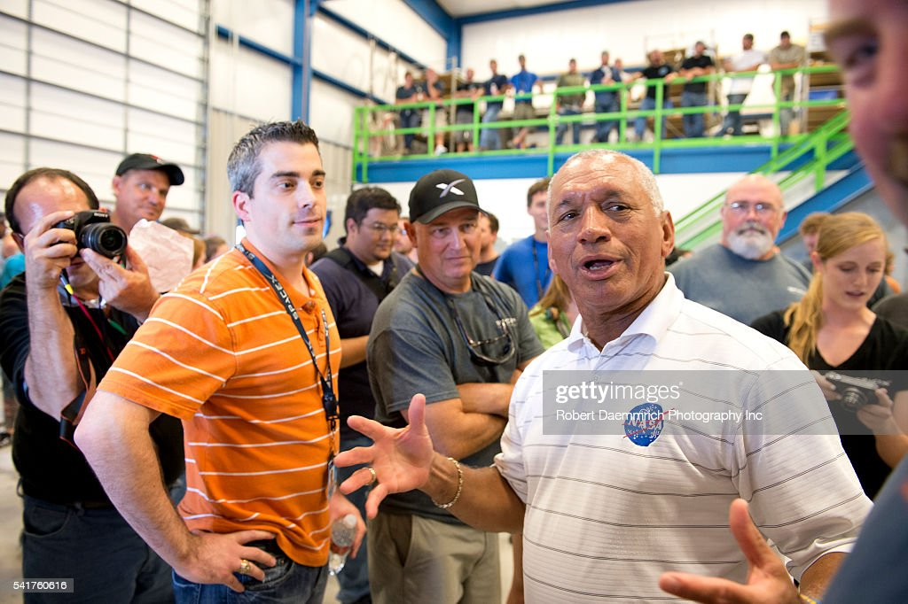 NASA administrator Charles Bolden right greets SpaceX employees after viewing the private Dragon spacecraft that returned to earth May 31st after...