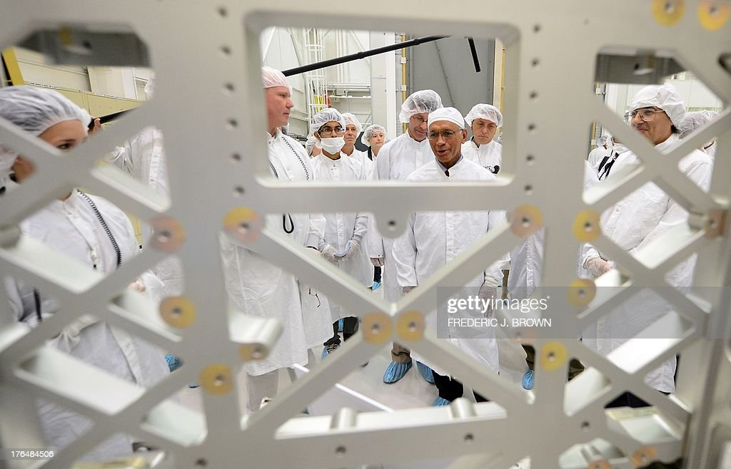 Administrator Charles Bolden tours the Spacecraft Assembly Facility Cleanroom at the Jet Propulsion Laboratory in Pasadena, California on August 13, 2013, where he views the Nadir Adaptable Structure Assembly unit while viewing the progress and assembly of the Soil Moisture Active Passive (SMAP) satellite presently under construction and due to launch in October 2014. SMAP will produce global maps of soil moisture for tracking water availability around the planet, and will also detect winter freeze and spring thaw to track changes in growing season patterns, allowing scientists to determine how much carbon plants take up from the atmosphere each year. AFP PHOTO/Frederic J. BROWN