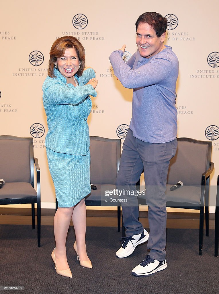 Administrator of the U.S. Small Business Administration Maria Contresras-Sweet and investor/media personality Mark Cuban pose for a photo on Day 2 of National Small Business Week 2016 at the United States Institute of Peace on May 2, 2016 in Washington City.