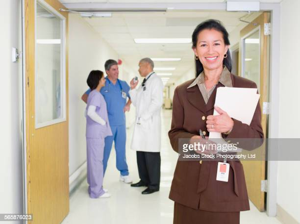 Administrator smiling in hospital hallway