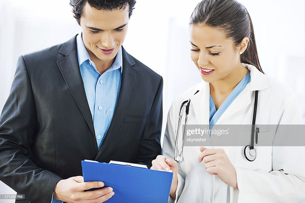 Administrator talking with a female doctor. : Stock Photo