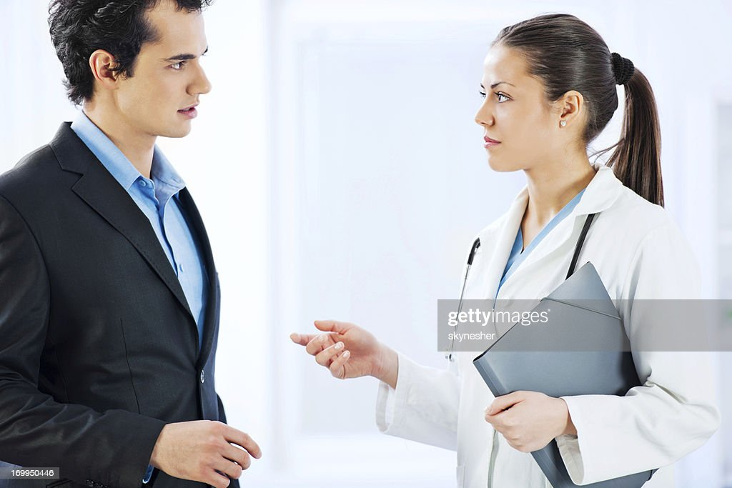 Administrator talking with female doctor. : Stock Photo