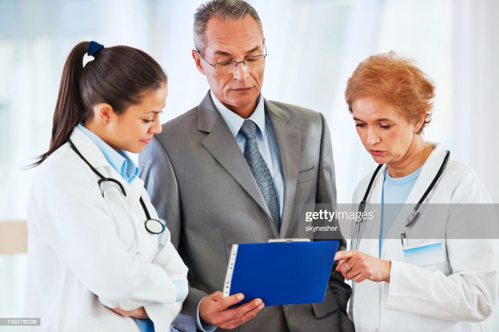 Administrator talking with Medical team at the Hospital. : Stock Photo