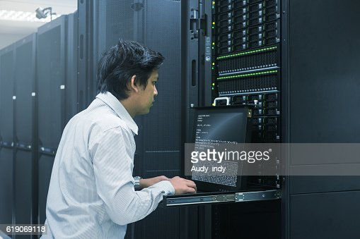 Administrator working in data center : Stock Photo