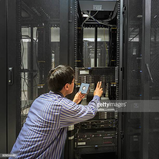 Administrator working on a server room