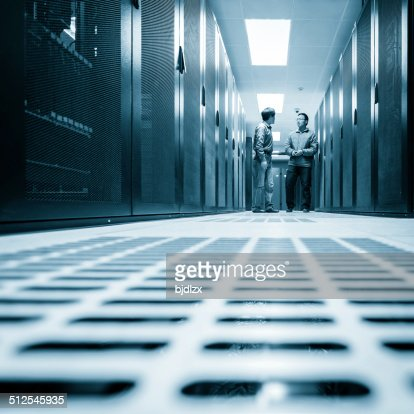 Administrators working on a server room