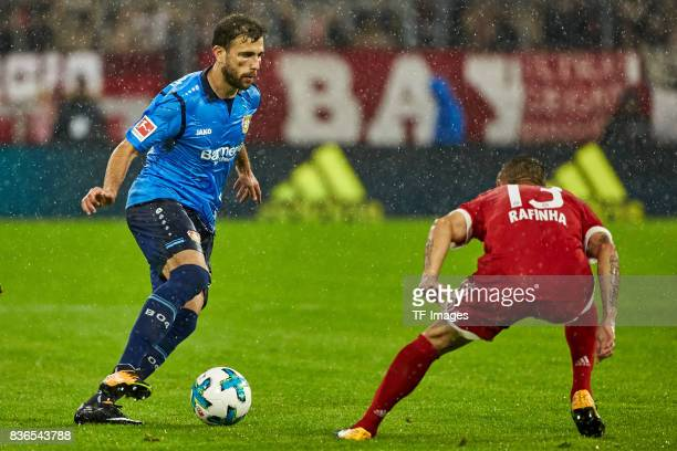 Admir Mehmedi and Rafinha of Muenchen battle for the ball during the Bundesliga match between FC Bayern Muenchen and Bayer 04 Leverkusen at Allianz...