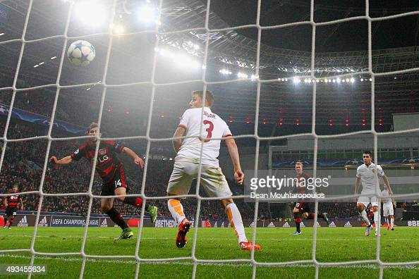 Admir Mehmedi of Bayer Levekusen scores their fourth and equalising goal as defender Lucas Digne of AS Roma looks on during the UEFA Champions League...