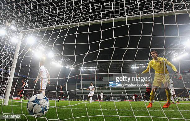 Admir Mehmedi of Bayer Levekusen scores their fourth and equalising goal as goalkeeper Wojciech Szczesny of AS Roma reacts during the UEFA Champions...