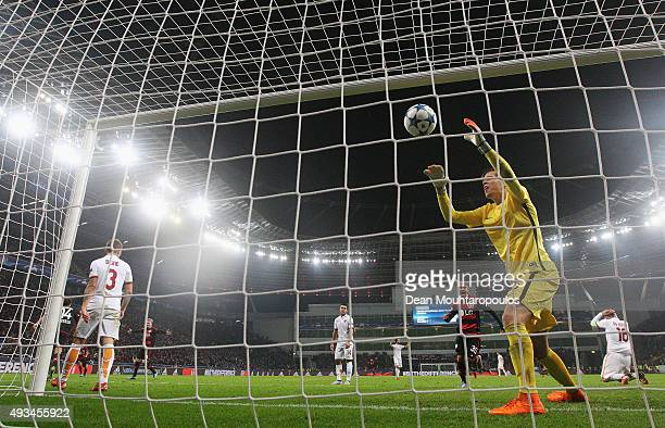 Admir Mehmedi of Bayer Levekusen scores their fourth and equalising goal as goalkeeper Wojciech Szczesny of AS Roma grabs the ball from the net...