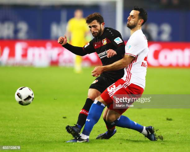 Admir Mehmedi of Bayer Leverkusen challenegs Mergim Mavraj of Hamburger SV during the Bundesliga match between Hamburger SV and Bayer 04 Leverkusen...