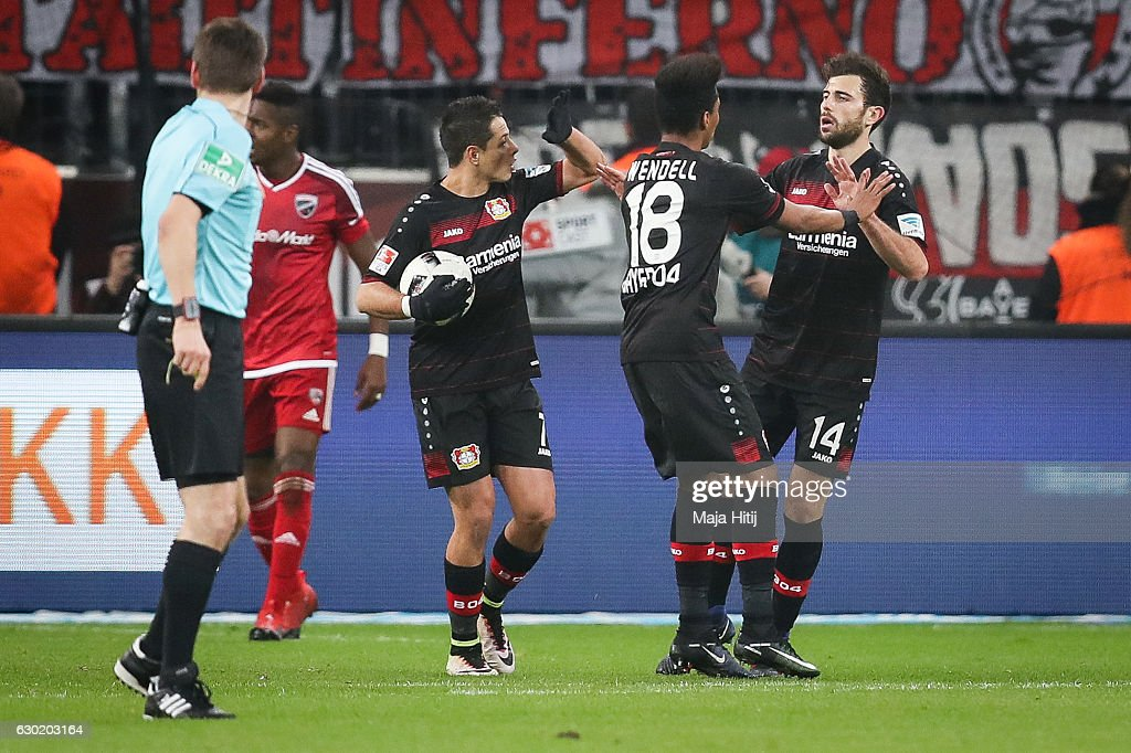Admir Mehmedi (R) of Leverkusen celebrates with his team-mates after scoring a goal to make it 1-1 during the Bundesliga match between Bayer 04 Leverkusen and FC Ingolstadt 04 at BayArena on December 18, 2016 in Leverkusen, Germany.