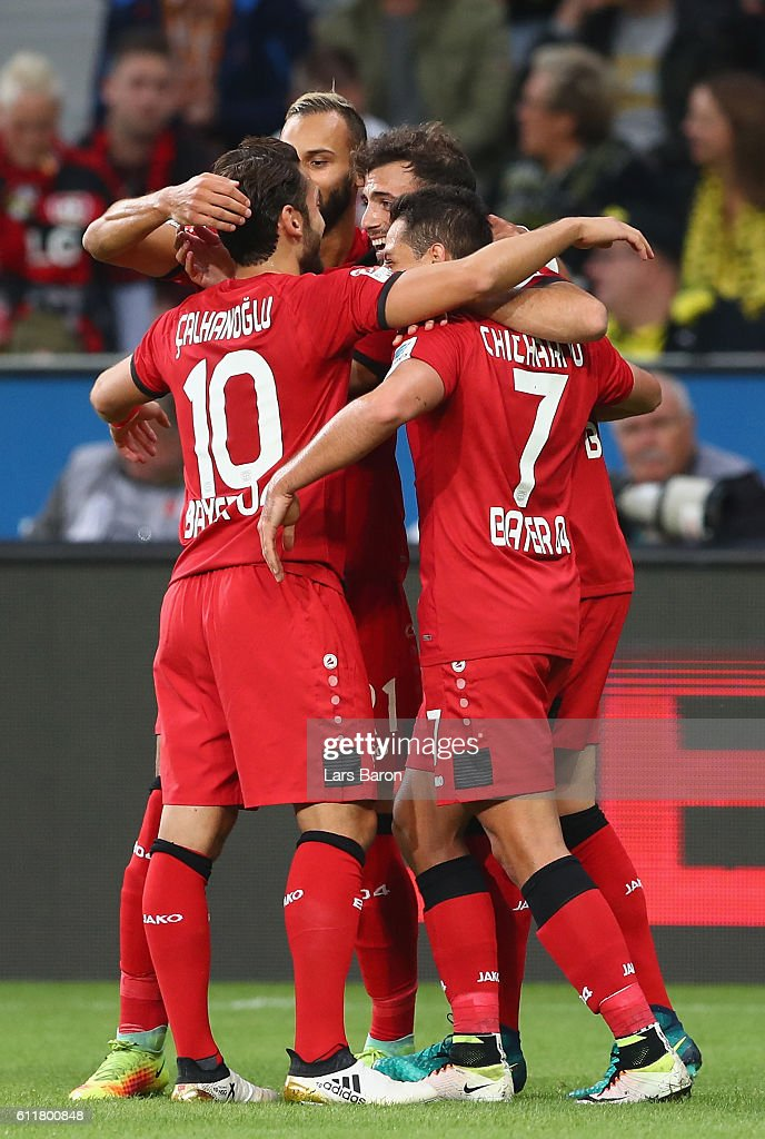 Admir Mehmedi of Leverkusen celebrates with team mates after scoring his teams first goal during the Bundesliga match between Bayer 04 Leverkusen and Borussia Dortmund at BayArena on October 1, 2016 in Leverkusen, Germany.