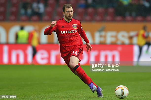 Admir Mehmedi of Leverkusen runs with the ball during the Bundesliga match between FC Augsburg and Bayer Leverkusen at WWK Arena on March 5 2016 in...