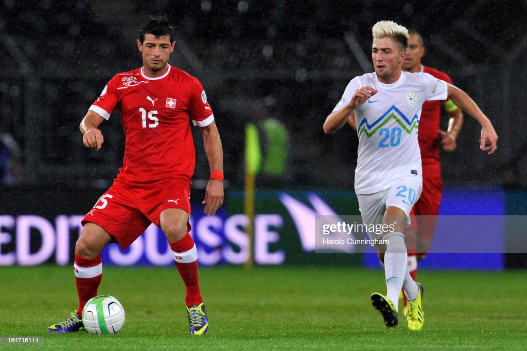 Admir Mehmedi of Switzerland and Kevin Kampl of Slovenia in action during the FIFA 2014 World Cup Qualifier match between Switzerland and Slovenia match held at Stade de Suisse on October 15, 2013 in Bern, Switzerland.