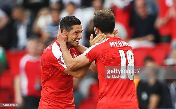 Admir Mehmedi of Switzerland celebrates scoring with Blerim Dzemaili of Switzerland during the UEFA EURO 2016 Group A match between Romania and...