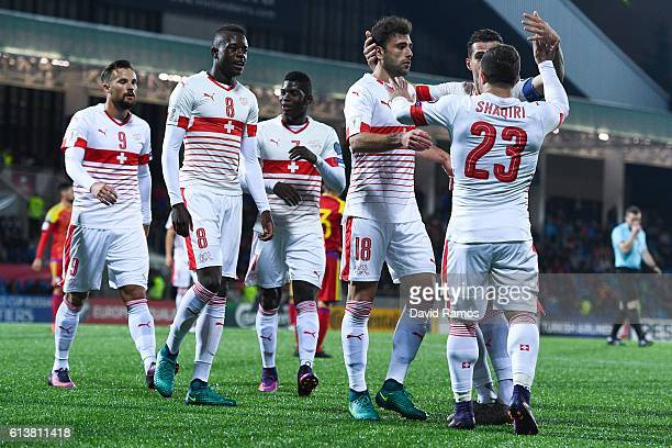 Admir Mehmedi of Switzerland celebrates with his team mates after scoring his team's second goal during the FIFA 2018 World Cup Qualifier between...