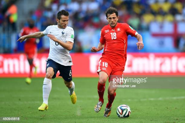 Admir Mehmedi of Switzerland controls the ball against Yohan Cabaye of France during the 2014 FIFA World Cup Brazil Group E match between Switzerland...