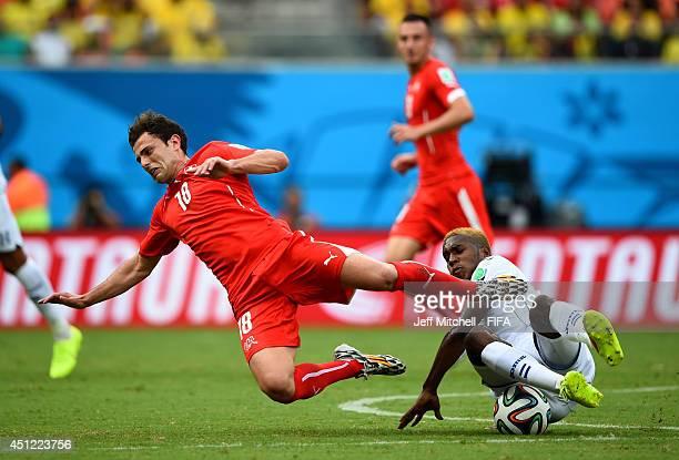 Admir Mehmedi of Switzerland is tackled by Brayan Beckeles of Honduras during the 2014 FIFA World Cup Brazil Group E match between Honduras and...