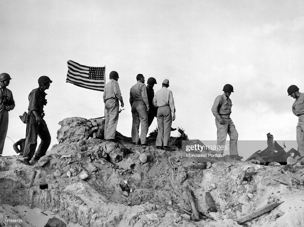 US Admiral Chester William Nimitz, his staff officers and some soldiers watching military operations from the island's highest peak. Kwajalein, April 1944