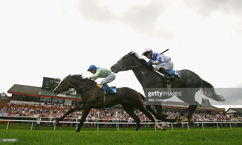 Admiral Dundas ridden by Joe Fanning (1) beats Thumbs Up ridden by Jamie Spencer to win the Style Bar & Bar Liquid Pontefract Handicap Stakes run at Pontefract Racecourse on August 6, 2008 in Pontefract, England.