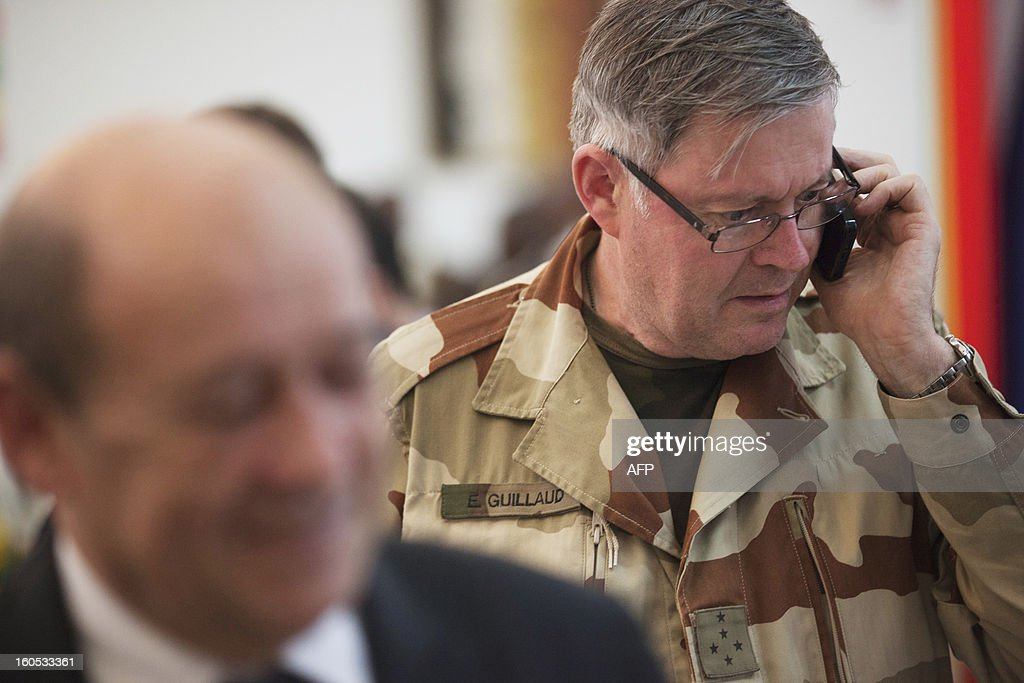 Admiral Edouard Guillaud, France's armies chief of staff, speaks on a mobile phone at the presidential palace in Bamako on February 2, 2013. France's President Francois Hollande received a rapturous welcome today as he visited Mali to push for African troops to take over a French-led offensive that drove back Islamist rebels from the country's desert north. POOL