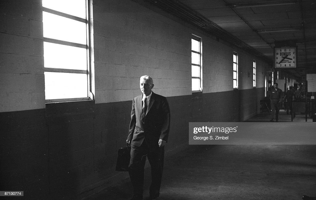 Admiral Hyman Rickover the father of the Nuclear Navy walks down the halls of an unidentified administrative building in Washington DC ca1960s