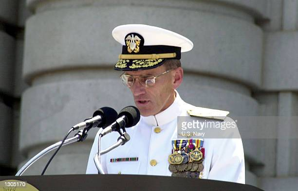 Admiral Jay L Johnson reads his orders prior to being relieved as Chief of Naval Operations by Admiral Vern Clark July 21 2000 during a retirement...