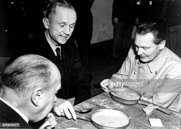 Admiral Karl Doenitz Fuhrer of the German Reich after Hitler's suicide eats with former Reichsmarschall Hermann Goering under guard during the...