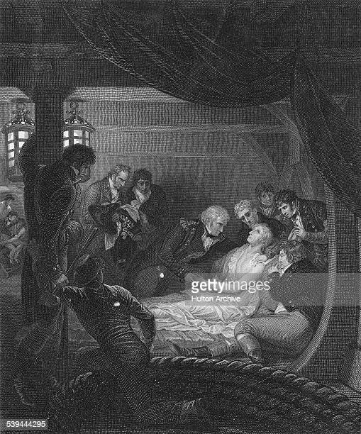 Admiral Lord Horatio Nelson lays mortally wounded in the cockpit of his flagship the HMS Victory and is attended by Dr William Beatty and Captain...