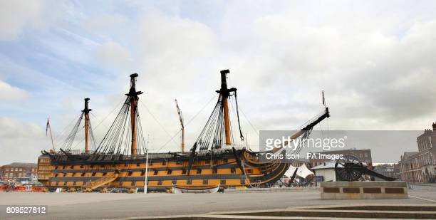 Admiral Lord Nelson's famous flagship HMS Victory stands minus her topmasts and bowsprit at the Royal Navy Dockyard in Portsmouth