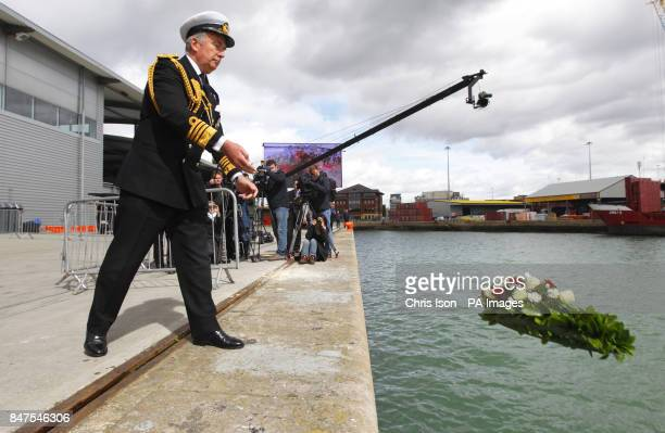 Admiral Lord West casts a memorial wreath to victims of the Titanic disaster into the dock in Southampton from where the illfated liner sailed 100...
