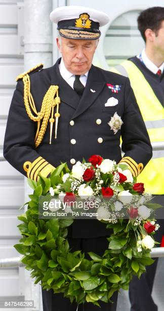Admiral Lord West joins descendants of victims of the Titanic disaster for a minute's silence before casting a wreath into the dock in Southampton...