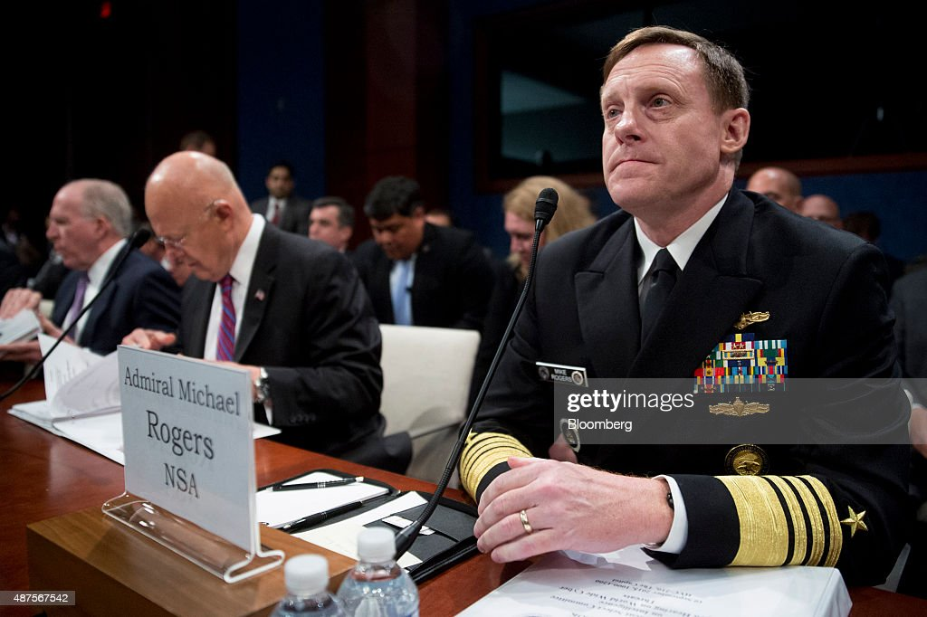 Admiral Michael Rogers director of the National Security Agency right arrives to a House Intelligence Committee hearing with John Brennan director of...