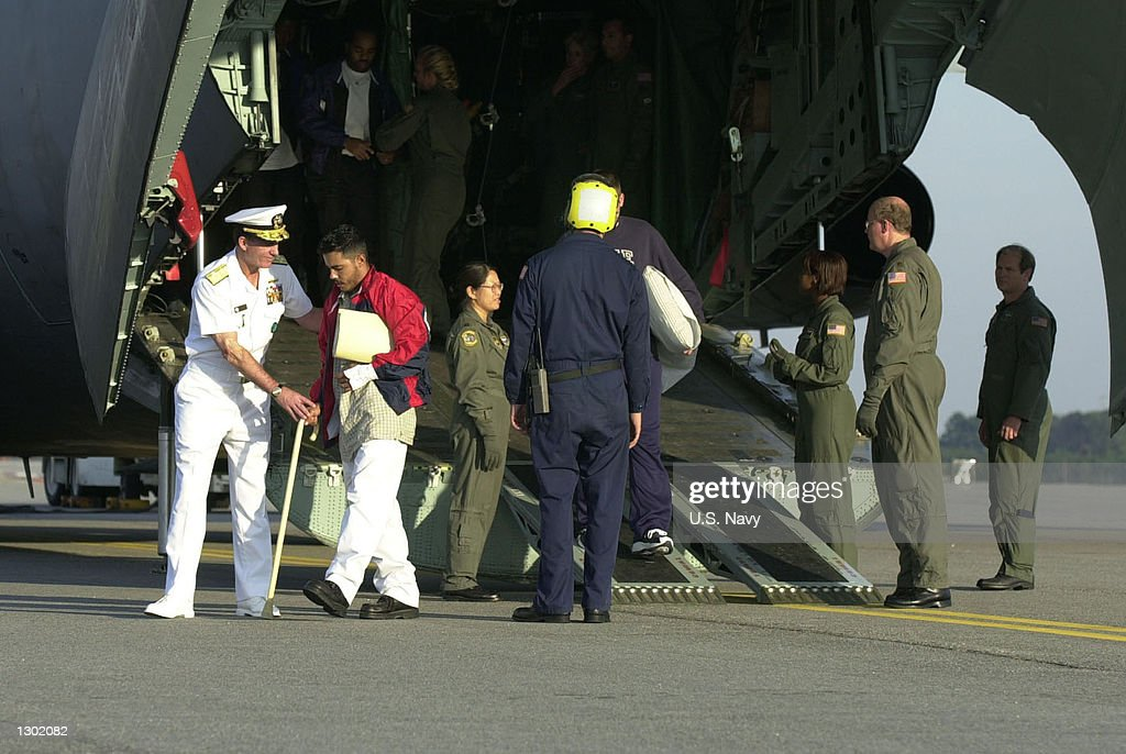 Admiral Robert J. Natter, Commander in Chief of the U.S. Atlantic Fleet, welcomes home the injured sailors from the USS Cole (DDG-67) October 15, 2000 at the Naval Air Station in Norfolk, VA. 33 Sailors were injured when a suspected terrorist bomb struck the U.S. Navy destroyer USS Cole October 12. Six remaining injured are staying in Ramstein, Germany, until their condition becomes more stable.