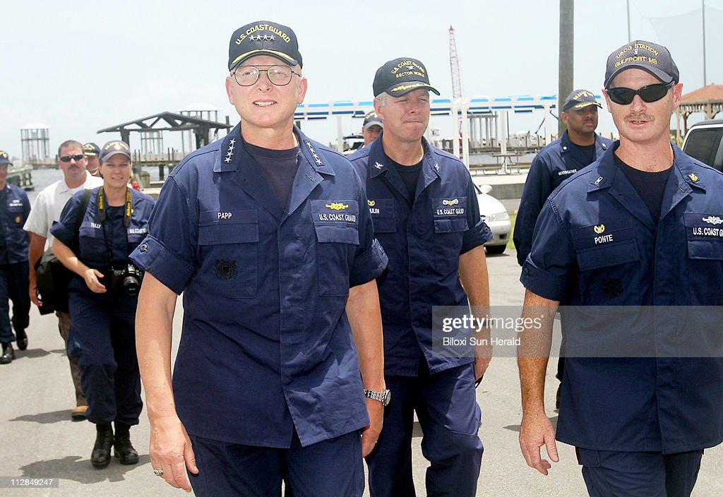 Admiral Robert Papp Commandant of the US Coast Guard foreground left takes a tour of the United States Coast Guard Station Gulfport on Wednesday July...