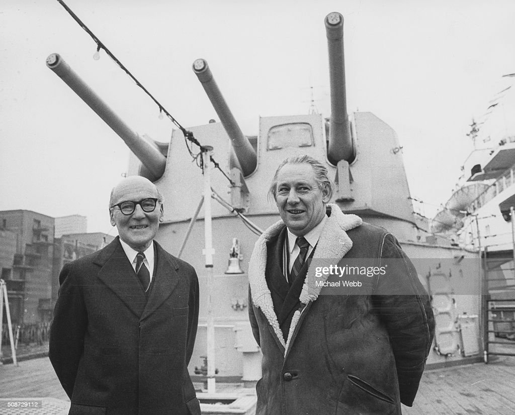 Admiral Sir Frederick Parham former commander of the HMS Belfast and Helmut Voekhoff a survivor of the sinking of the German battleship Scharnhorst...
