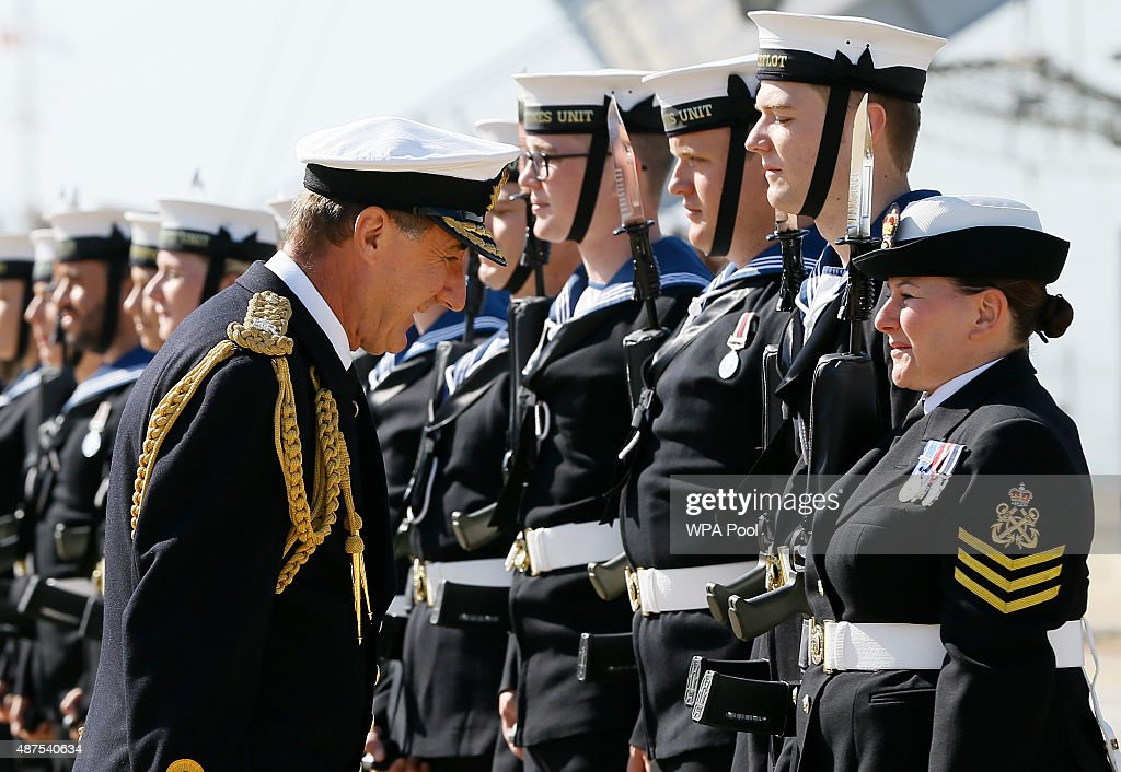 Admiral Sir George Zambellas inspects the guards before he presents medals for support of the Ebola Crisis and the end of Operation Gritrock to Naval...