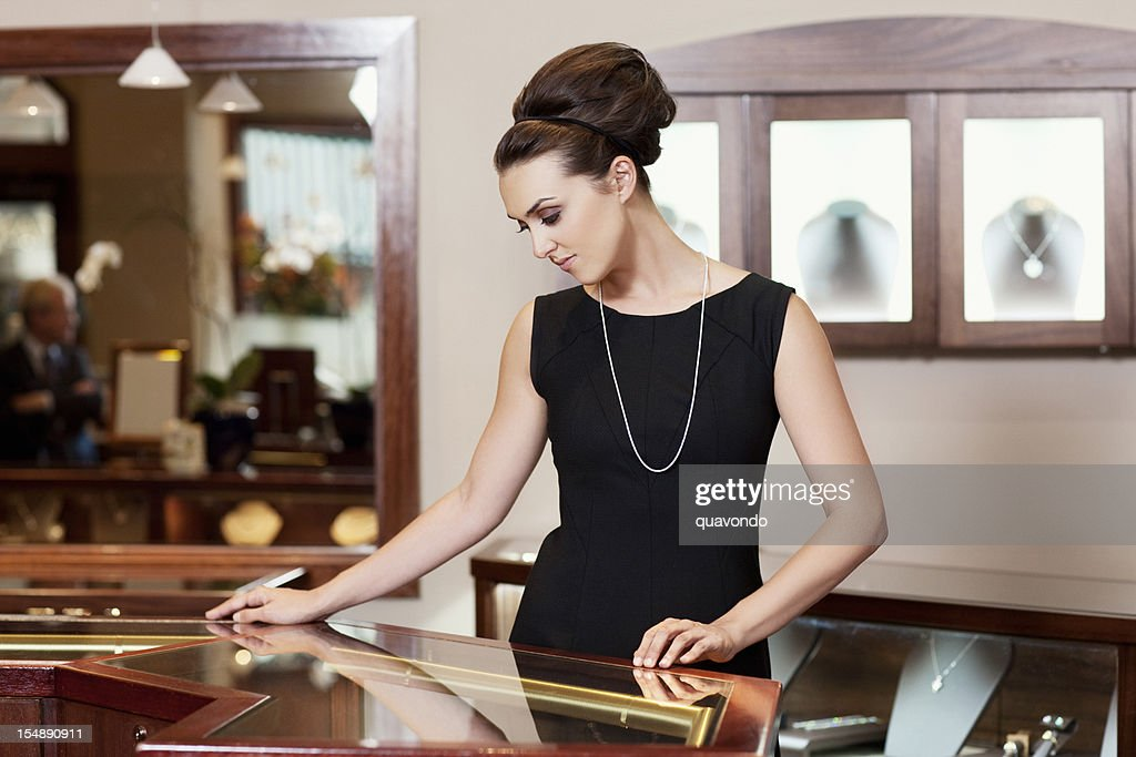 Admiring, Beautiful Young Woman in Jewelry Store, Copy Space