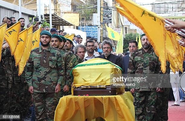 Adnan and Hassan Badreddine brothers of slain top Hezbollah commander Mustafa Badreddine who was killed in an attack in Syria mourn next to his...