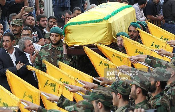 Adnan Badreddine brother of slain top Hezbollah commander Mustafa Badreddine who was killed in an attack in Syria is comforted by Lebanon's Minister...