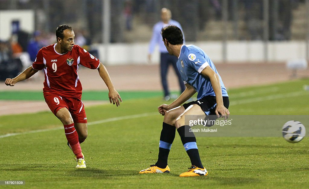 Adnan Hasan of Jordan tries to pass during the FIFA 2014 World Cup Qualifier: Intercontinental Play-off First Leg between Jordan and Uruguay on November 13, 2013 in Amman, Jordan.