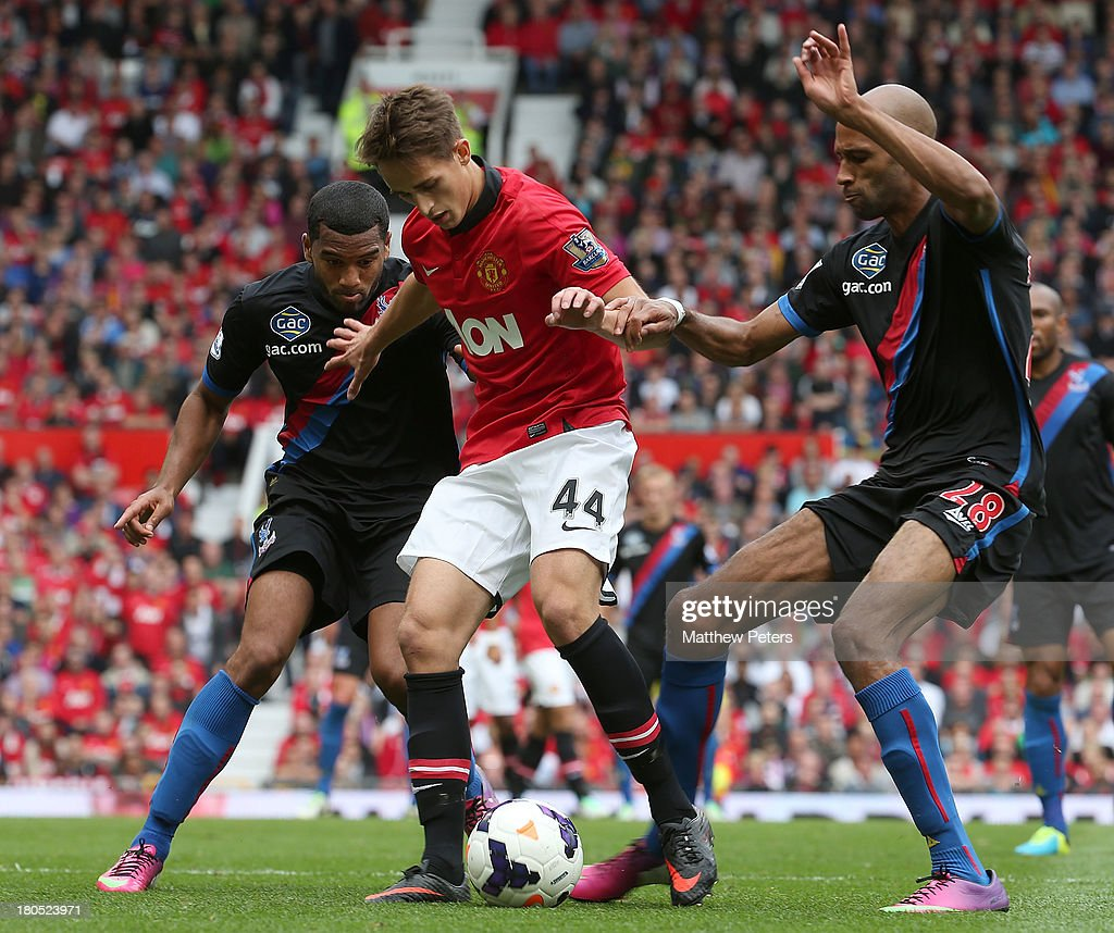 Adnan Janujaz of Manchester United in action with Jason Puncheon and Jimmy Kebe of Crystal Palace during the Barclays Premier League match between Manchester United and Crystal Palace at Old Trafford on September 14, 2013 in Manchester, England.
