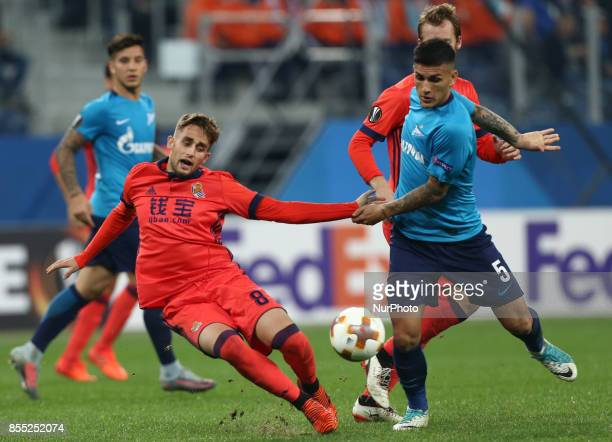 Adnan Januzaj of FC Real Sociedad and Leandro Paredes of FC Zenit Saint Petersburg vie for the ball during the UEFA Europa League Group L football...