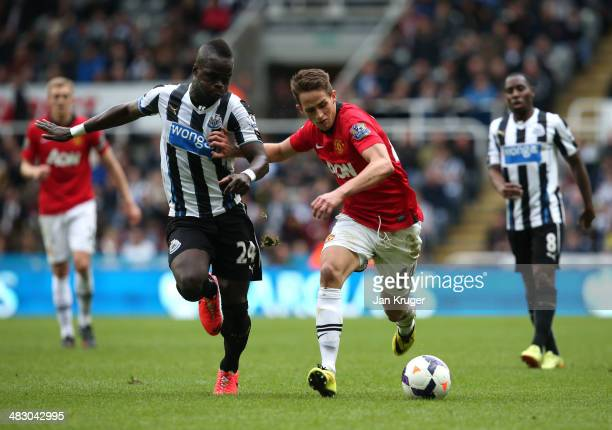 Adnan Januzaj of Manchester United battles with Cheik Ismael Tiote of Newcastle United during the Barclays Premier League match between Newcastle...