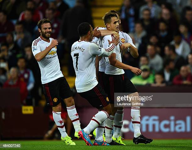Adnan Januzaj of Manchester United celebrates scoring the opening goal with Memphis Depay and Juan Mata of Manchester United during the Barclays...
